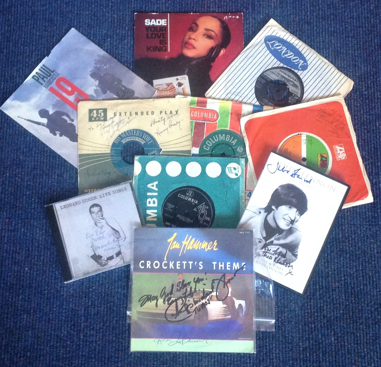Lot 14 - Music signed collection. Includes 8 signed 45rpm record sleeves with records. 1 signed cd insert