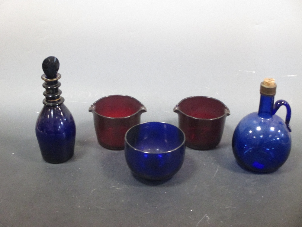 Lot 14 - A Regency Bristol blue decanter, finger bowl and two ruby glass rinsers