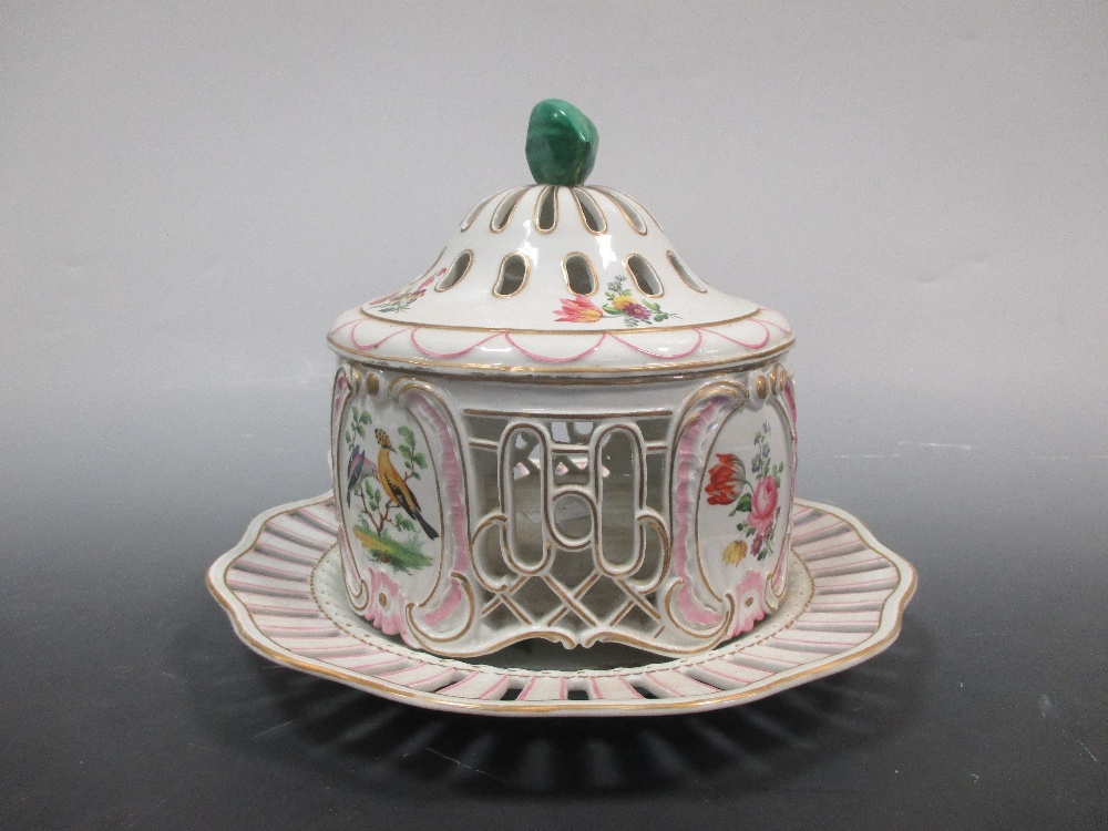 Lot 31 - A Continental porcelain lidded pot pourri vase and cover on stand, decorated with birds