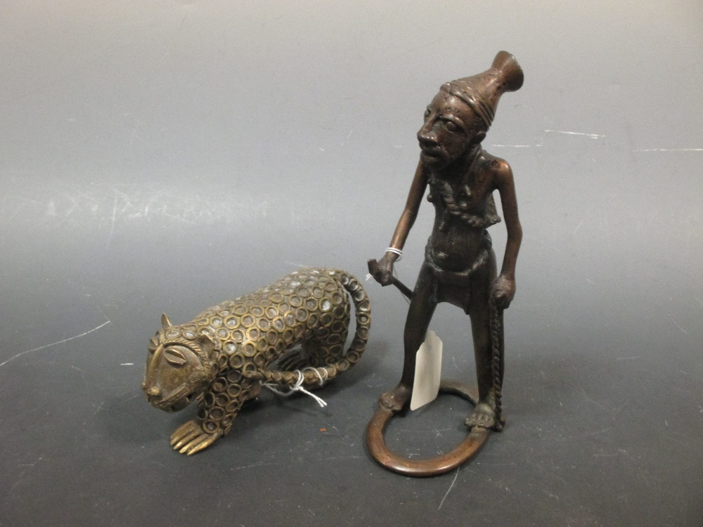 Lot 44 - A Benin bronze figure of a warrior together with a figure of a dog (2)