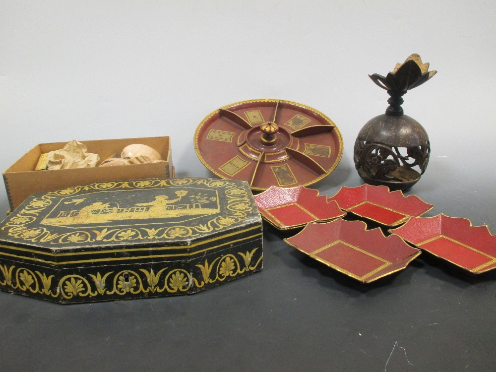 Lot 34 - A red lacquer roulette style wheel, painted with suits of cards, sea shells etc