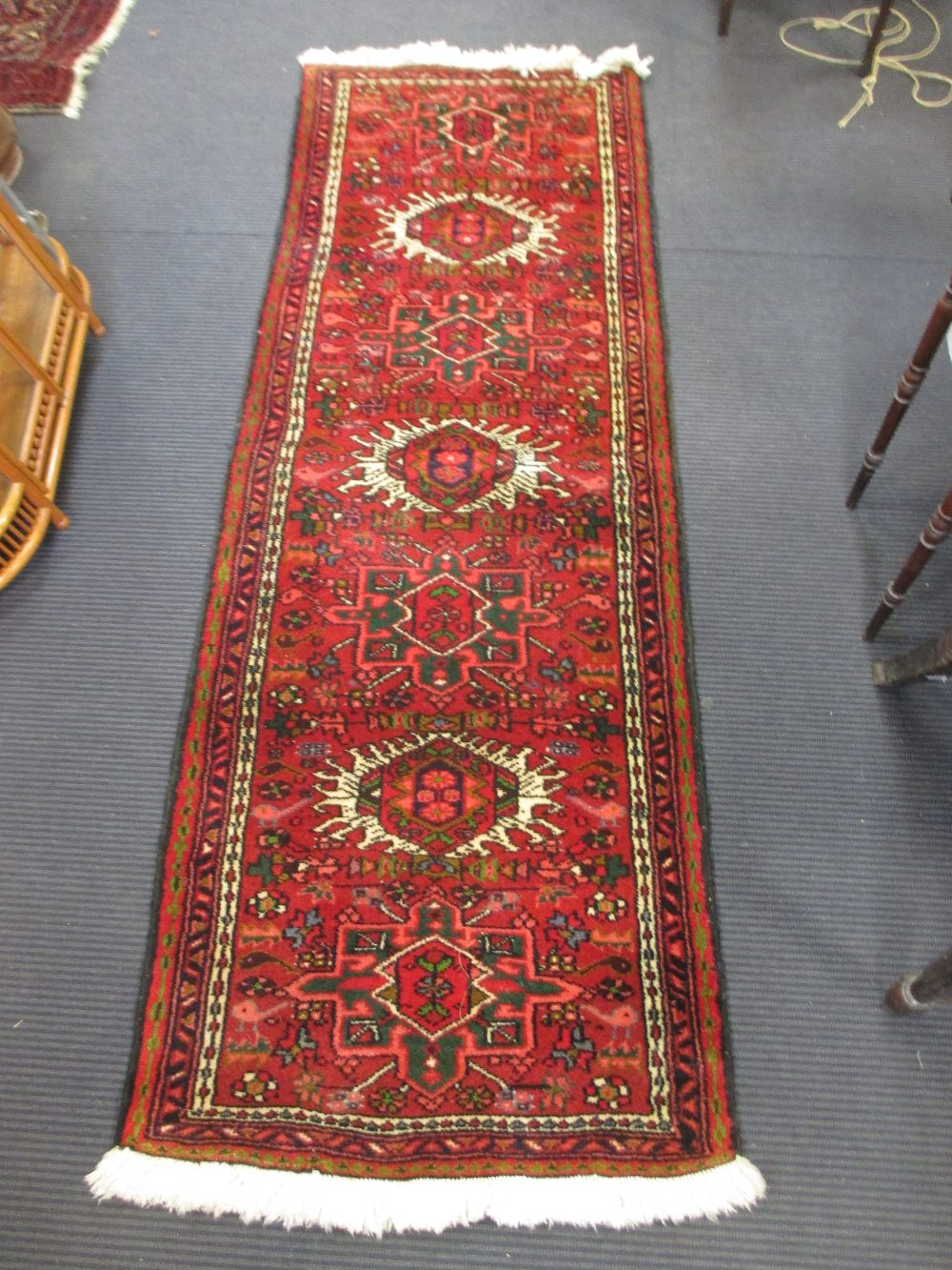 Lot 759 - Two modern Persian red ground runners, 290 x 69cm and 204 x 68cm(2)