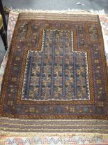Lot 760 - Four small tribal rugs including a prayer rug, 3 others with colourful fields, some fading and wear,