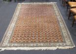 Lot 752 - A Persian carpet with mocha field, 285 x 203cm