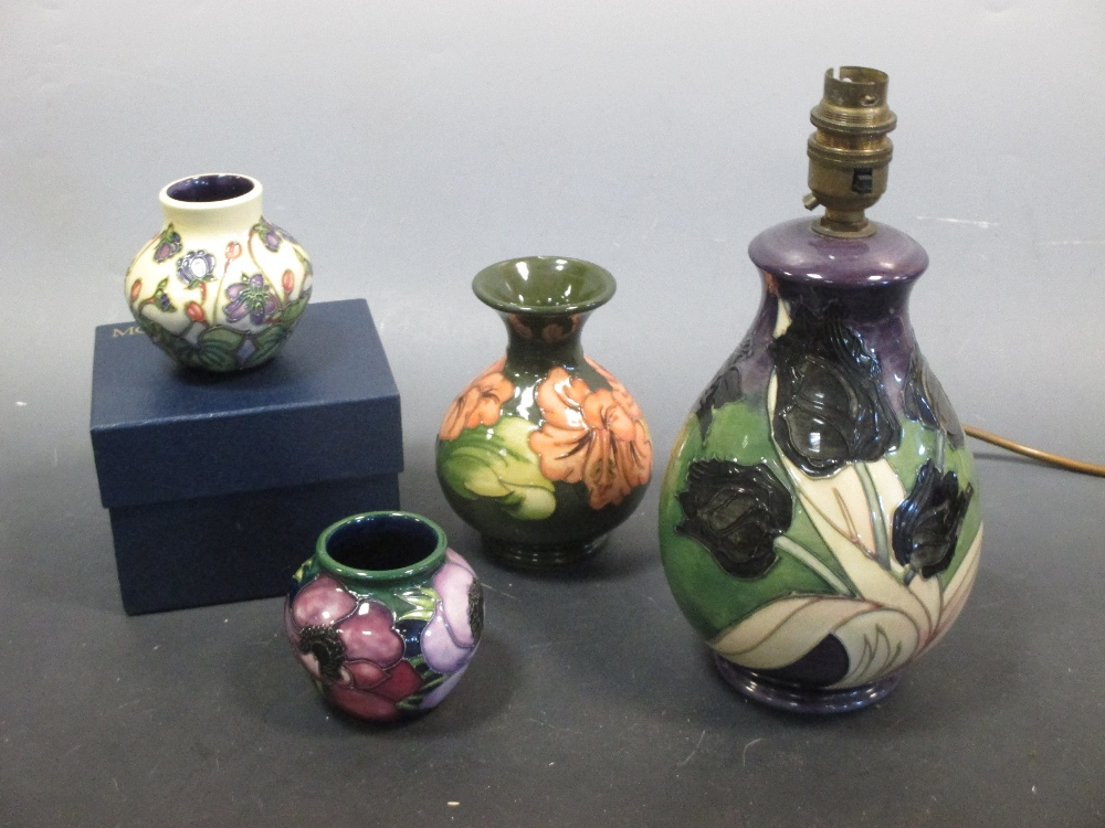 Lot 9 - A Moorcroft lamp base and three modern Moorcroft vases (one boxed)