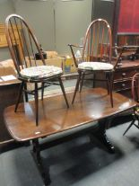 Lot 768 - An Ercol dining table and four chairs