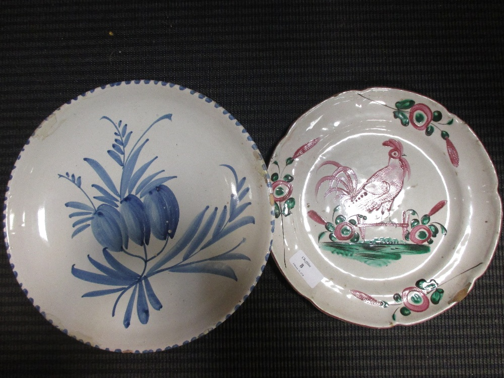 Lot 8 - Two French faience plates, decorated to the centres with cockerels; a Delft blue and white plate (3)