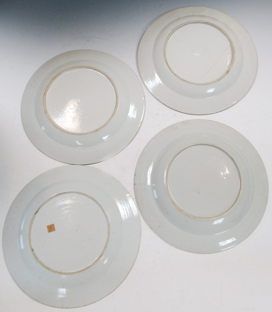 Lot 18 - A set of three and another 18th century famille rose plate, 23cm (9 in) diameter (4) One of the