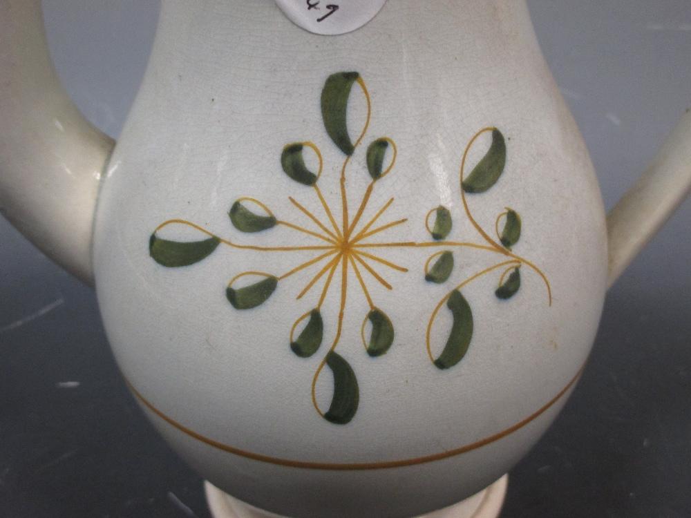 Lot 37 - A Pratt type coffee pot with broken lid