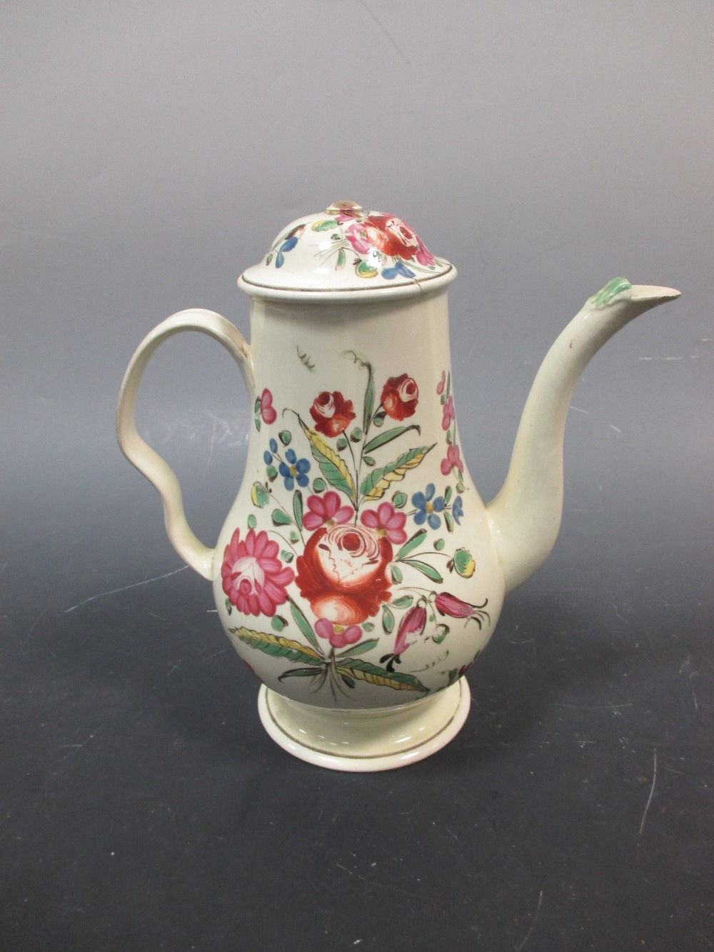 Lot 32 - A Leeds type floral coffee pot and broken cover