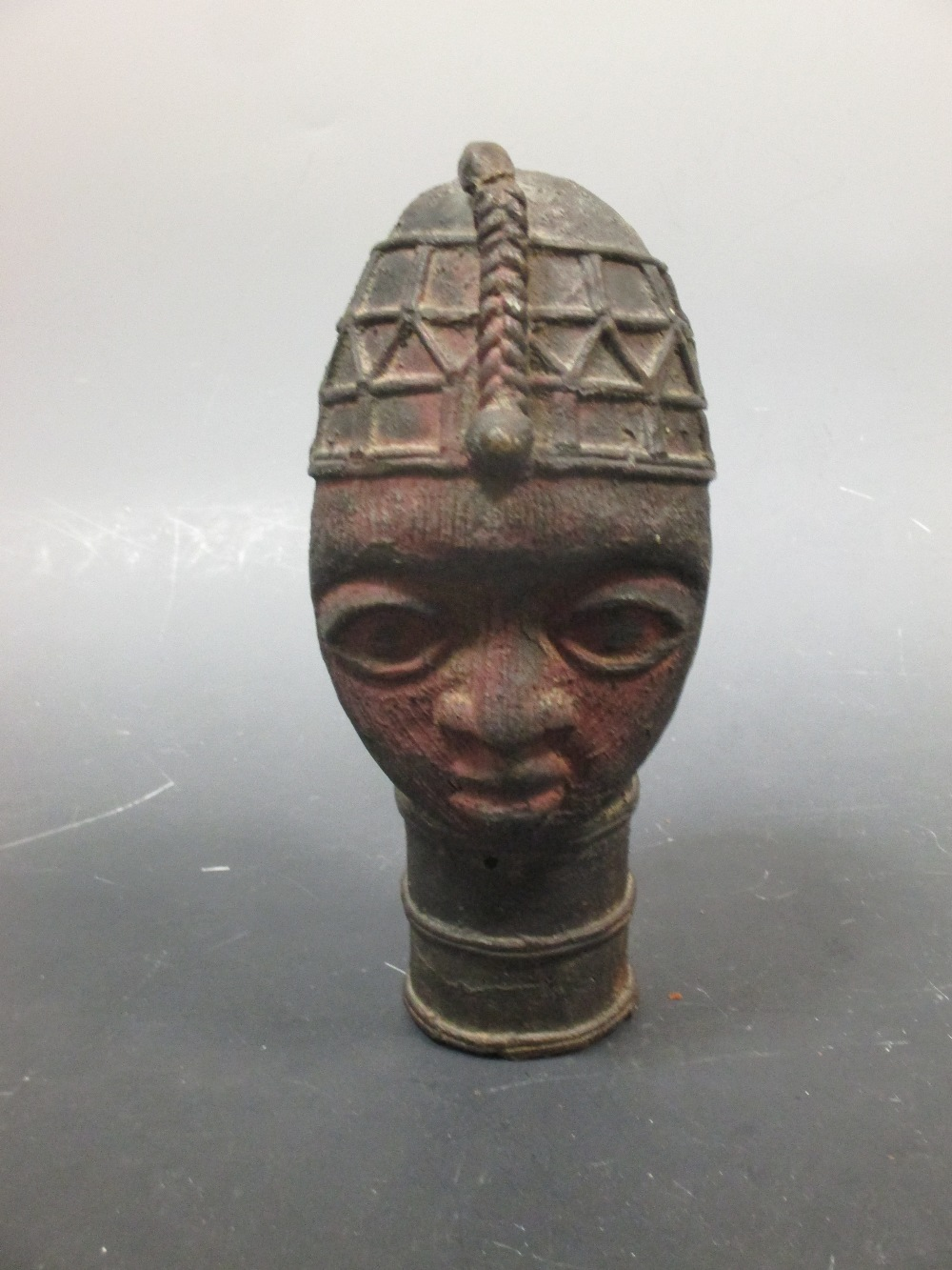 Lot 48 - An Ife bronze Ooni staff head