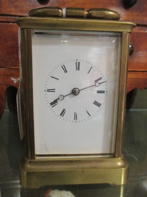 Lot 41 - A late 19th century brass cased carriage clock, striking on a bell