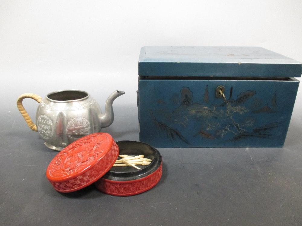 Lot 47 - A cinnabar lacquer box, spillikens, tea pot and a Chinese tea caddy