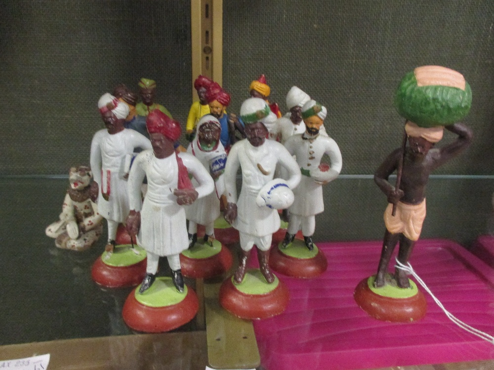 Lot 45 - A collection of Indian colonial painted plaster model figures, each c.11cm high