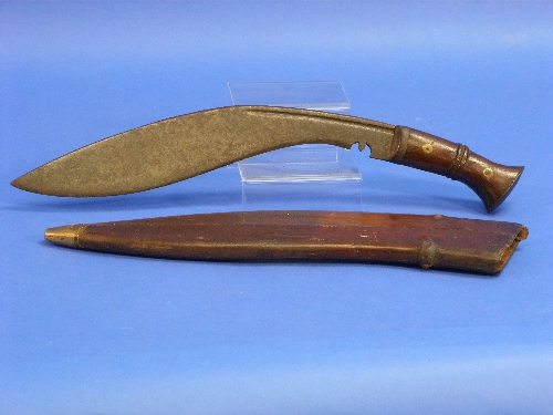 "Lot 1050 - A W.W.1 period military issue Kukri (Kukuri) Knife, marked ""17"" for 1917, with leather scabbard."