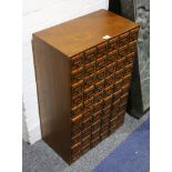 An oak office chest, early 20th Century, fitted with 60 small drawers, 49cm wide x 28cm deep x