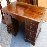 A George II style mahogany kneehole desk, early 20th Century,fitted with seven drawers around a