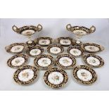 A Ridgway porcelain dessert service, early 19th century, with wide blue borders picked out in