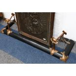 An Art Nouveau fender with bronze andirons, fitted to a cast iron fender, the fender 140cm long