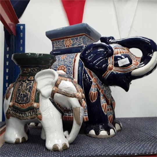 A Large And Small Ceramic Elephant Planters