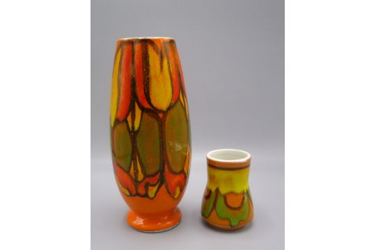A Poole Pottery Vase The Orange Ground With A Green And Yellow