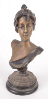 Lot 40 - A spelter female bust, late 19th/early 20th century on a circular ebonised plinth base, height 22cm,