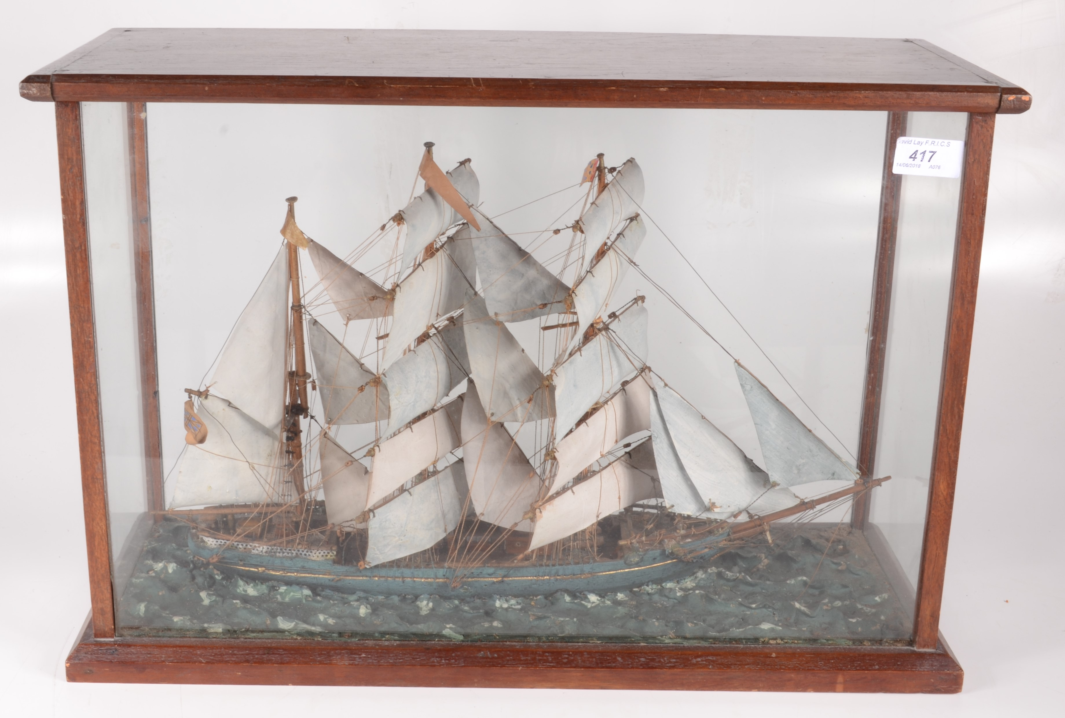 Lot 23 - A wooden model of a sailing ship, early 20th century, in a glazed mahogany case, height 37.
