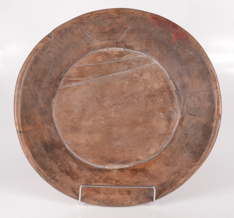 Lot 20 - A treen circular bowl, 19th century, height 7cm, diameter 39cm.