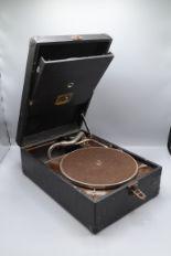 Lot 38 - An H.M.V. black portable gramophone height 14cm, width 28.5cm, depth 41.5cm.