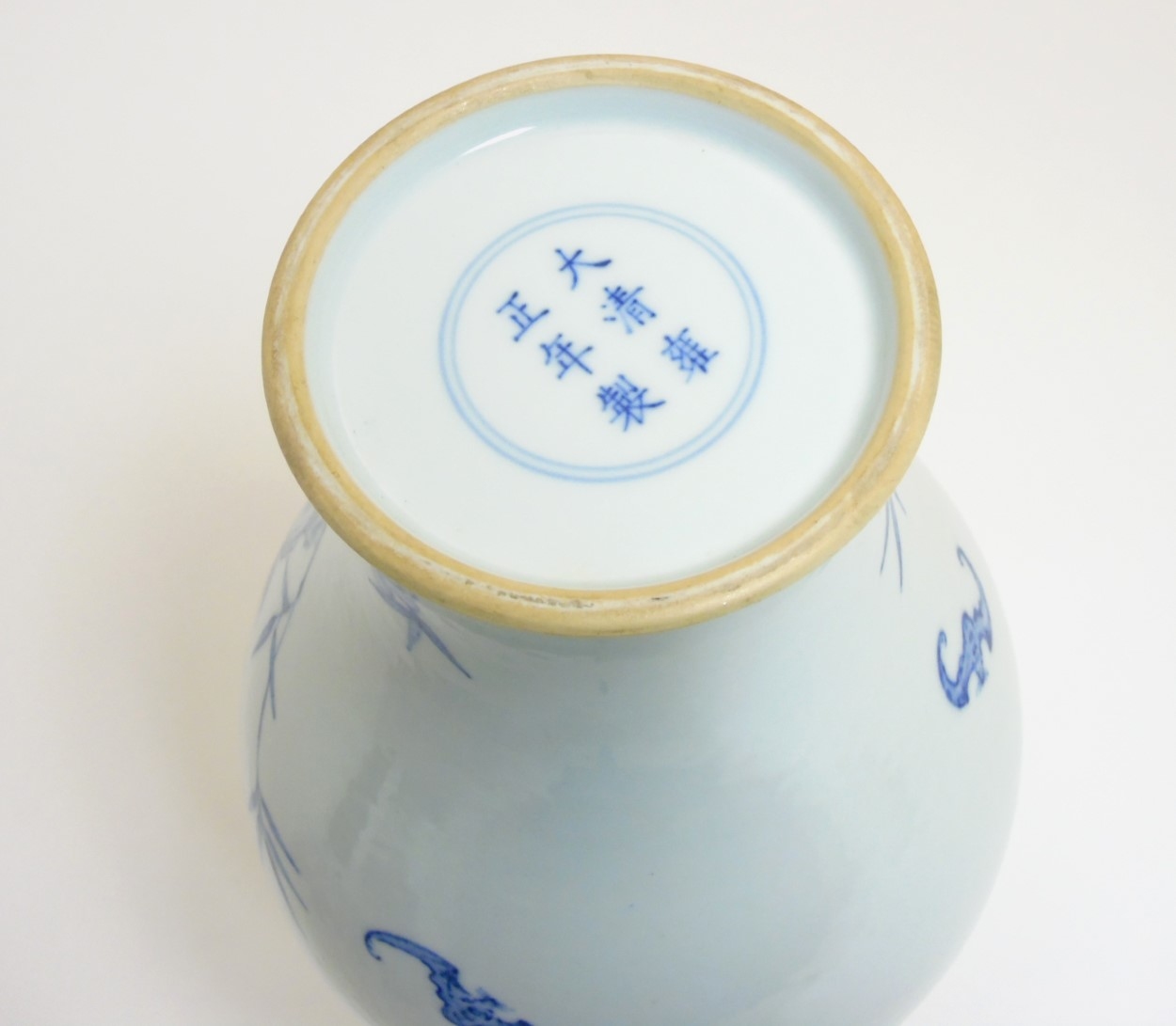 Lot 12 - A Chinese blue and white 'Bat and Fruit' vase,
