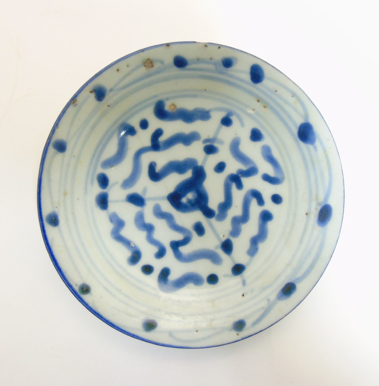 Lot 27 - An Oriental, possibly Japanese small dish in underglaze blue,