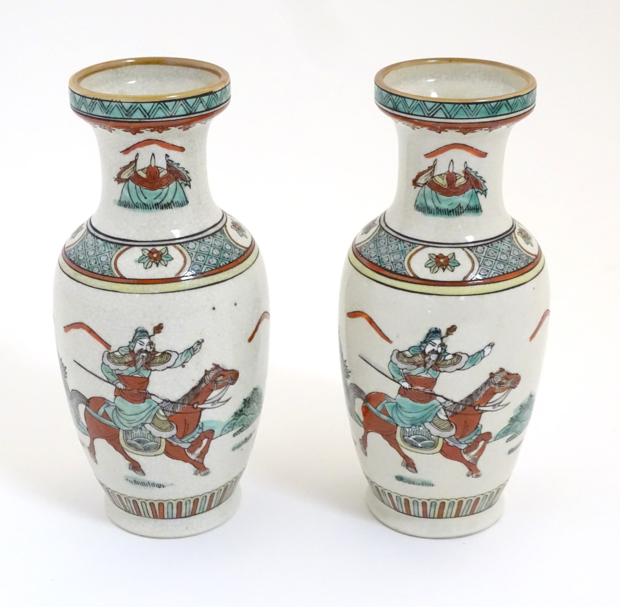 Lot 9 - A pair of Chinese rouleau vases decorated with a figure on horseback and a figure with a flag.