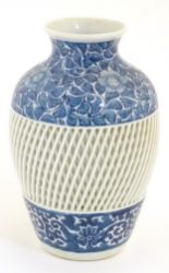 Lot 1 - A blue and white Chinese baluster vase decorated with a floral pattern and a reticulated banded