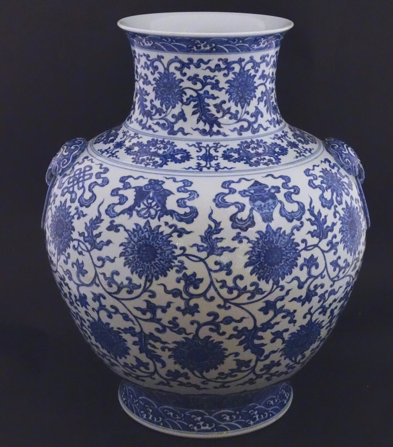 Lot 32 - A large Chinese blue and white vase, depicting scrolling lotus with shou character to centre flower,