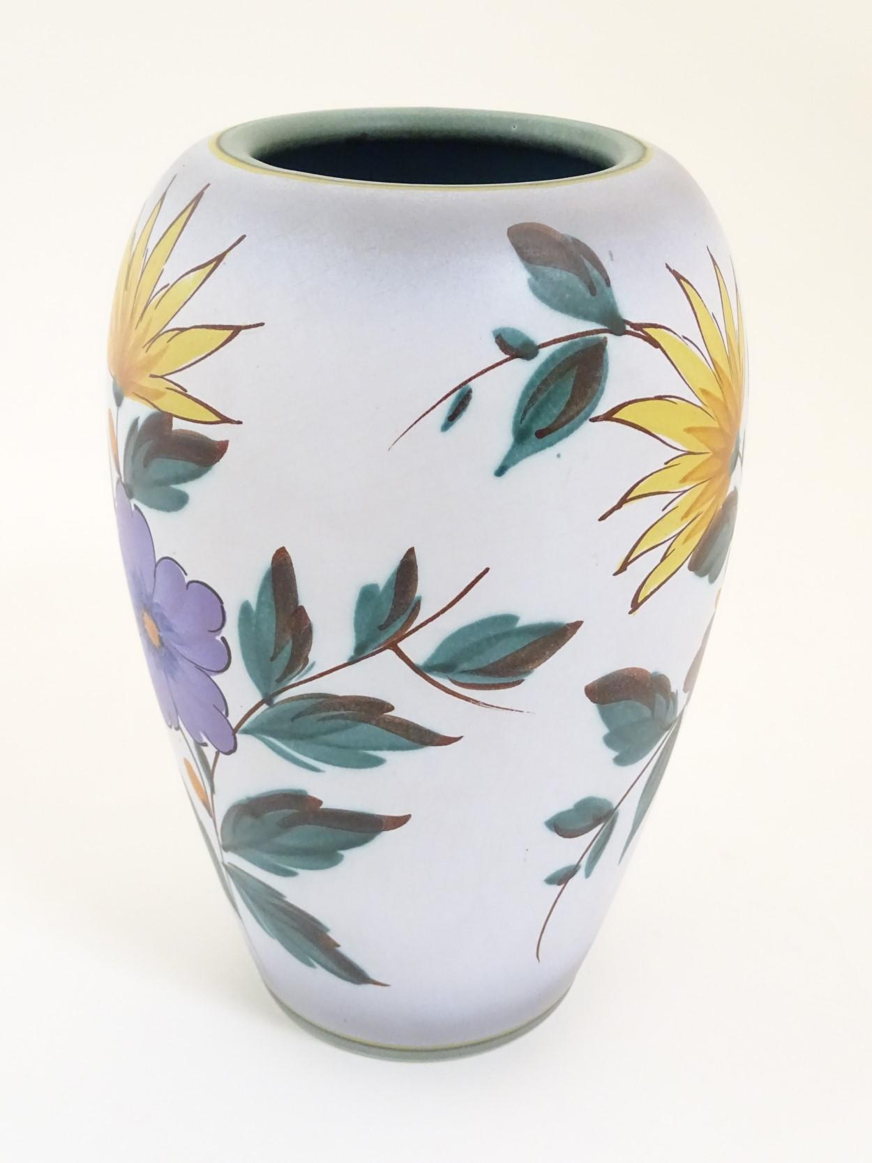 Lot 58 - A Viola pattern Gouda vase. Marked under 1493, Flora Gouda, Holland, Viola. Height: approx.