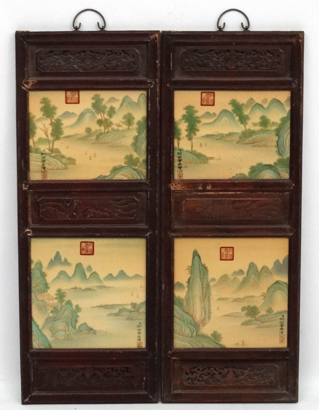 Lot 48 - A large pair of Chinese ceramic panels in wooden frames,