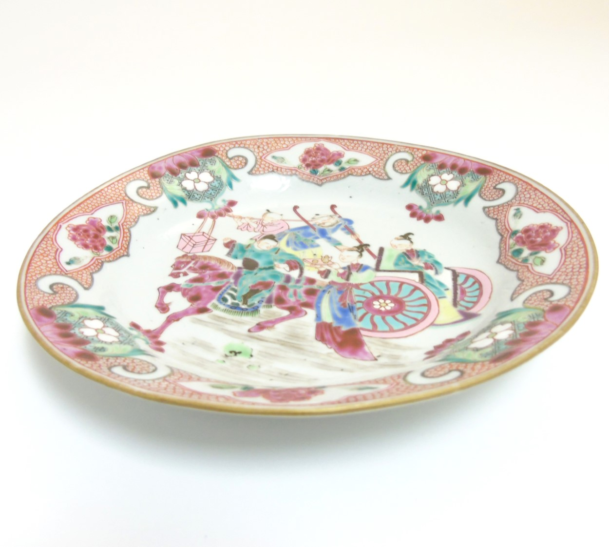 Lot 18 - A Chinese Famille Rose enamelled plate depicting a warrior on horseback and other oriental figures,