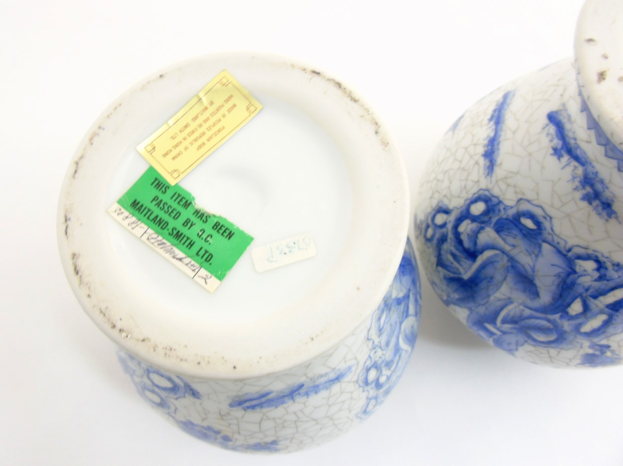 Lot 29 - A pair of Maitland Smith blue and white Oriental lidded vases with craquelure style decoration,