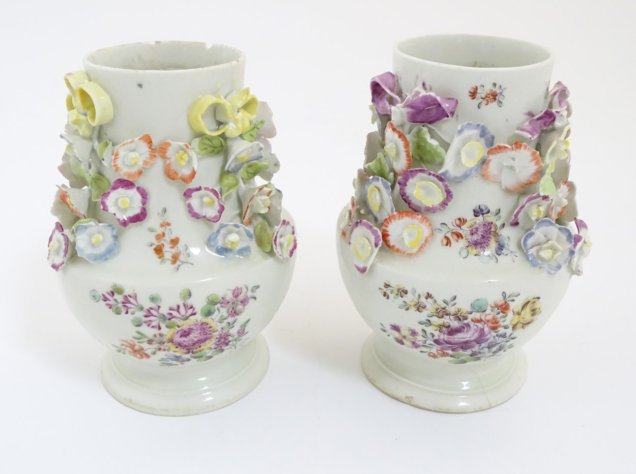 Lot 54 - Two rare mid 18thC Derby flower encrusted vases of pear shape,
