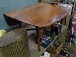 Lot 21 - An early Ercol drop leaf dining table CONDITION: Please Note - we do not make