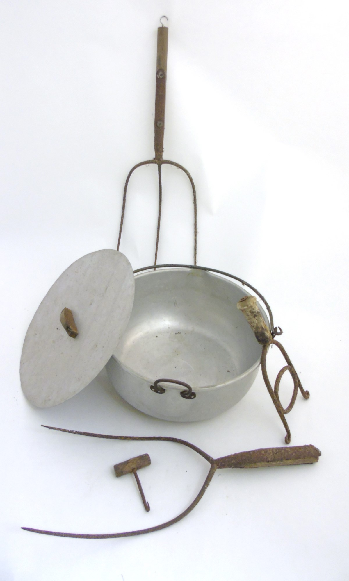 Lot 49 - Vintage Agricultural tools : A creamer with lid , wrought iron stirrer , bale / wad hook ,