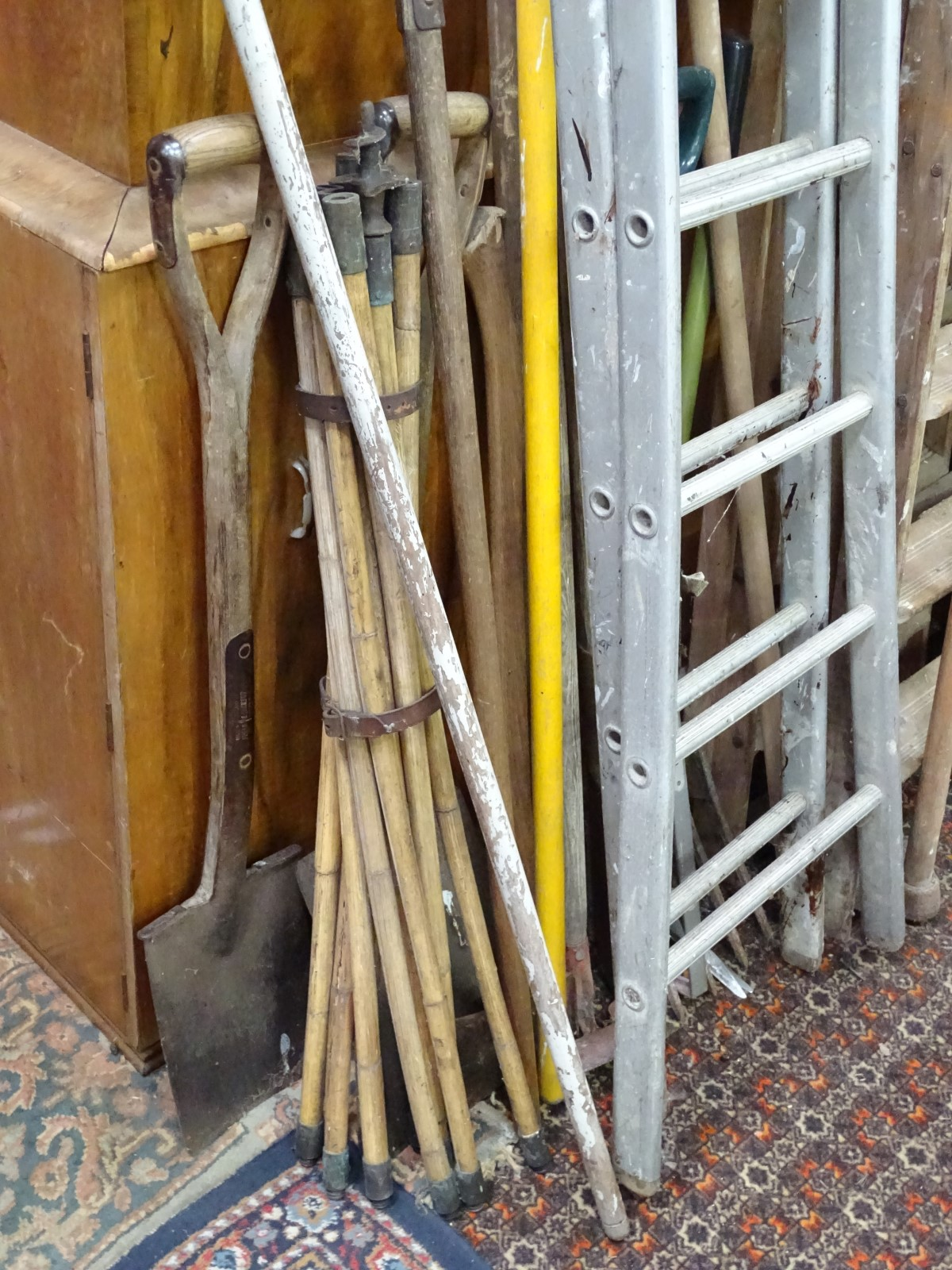 Lot 50 - A collection of long hand tools, ladders etc.