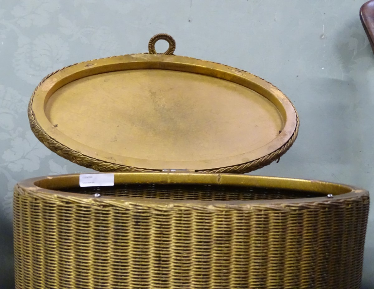 Lot 16 - A Lloyd loom style washing basket CONDITION: Please Note - we do not make
