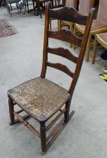 Lot 61 - An old elm rush seater rocking chair CONDITION: Please Note - we do not make