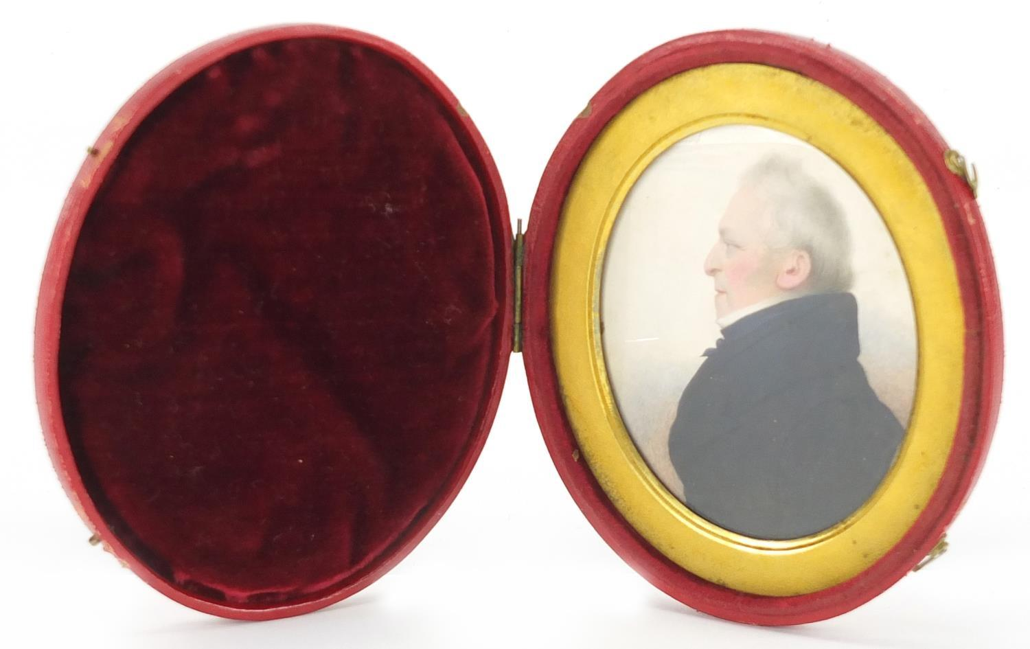 Lot 5 - 19th century oval hand painted portrait miniature of a gentleman in formal dress, with gilt aperture