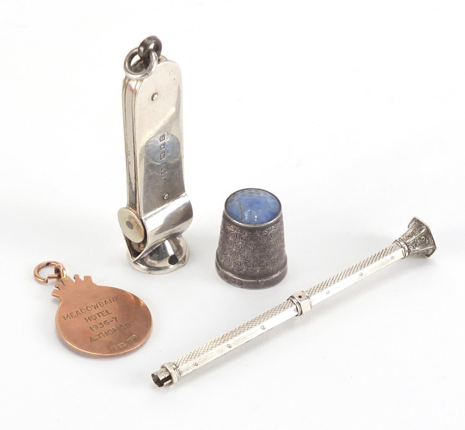 Lot 44 - Miscellaneous objects including a 9ct gold and enamel dart jewel, silver cigar cutter and silver and