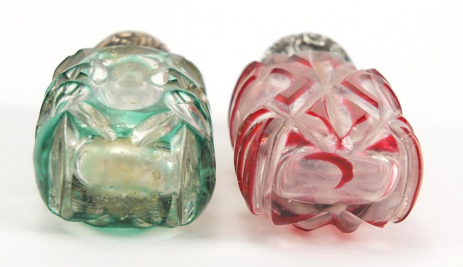 Lot 8 - Two Victorian flashed cut glass scent bottles with unmarked silver mounts, one with stopper, the