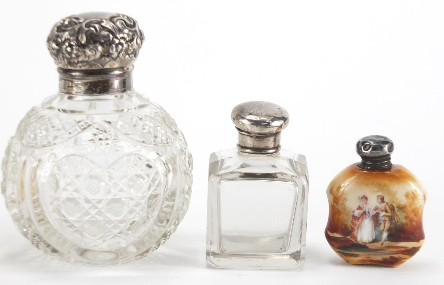 Lot 9 - Six silver mounted scent bottles including a globular cut glass example and two faceted ruby