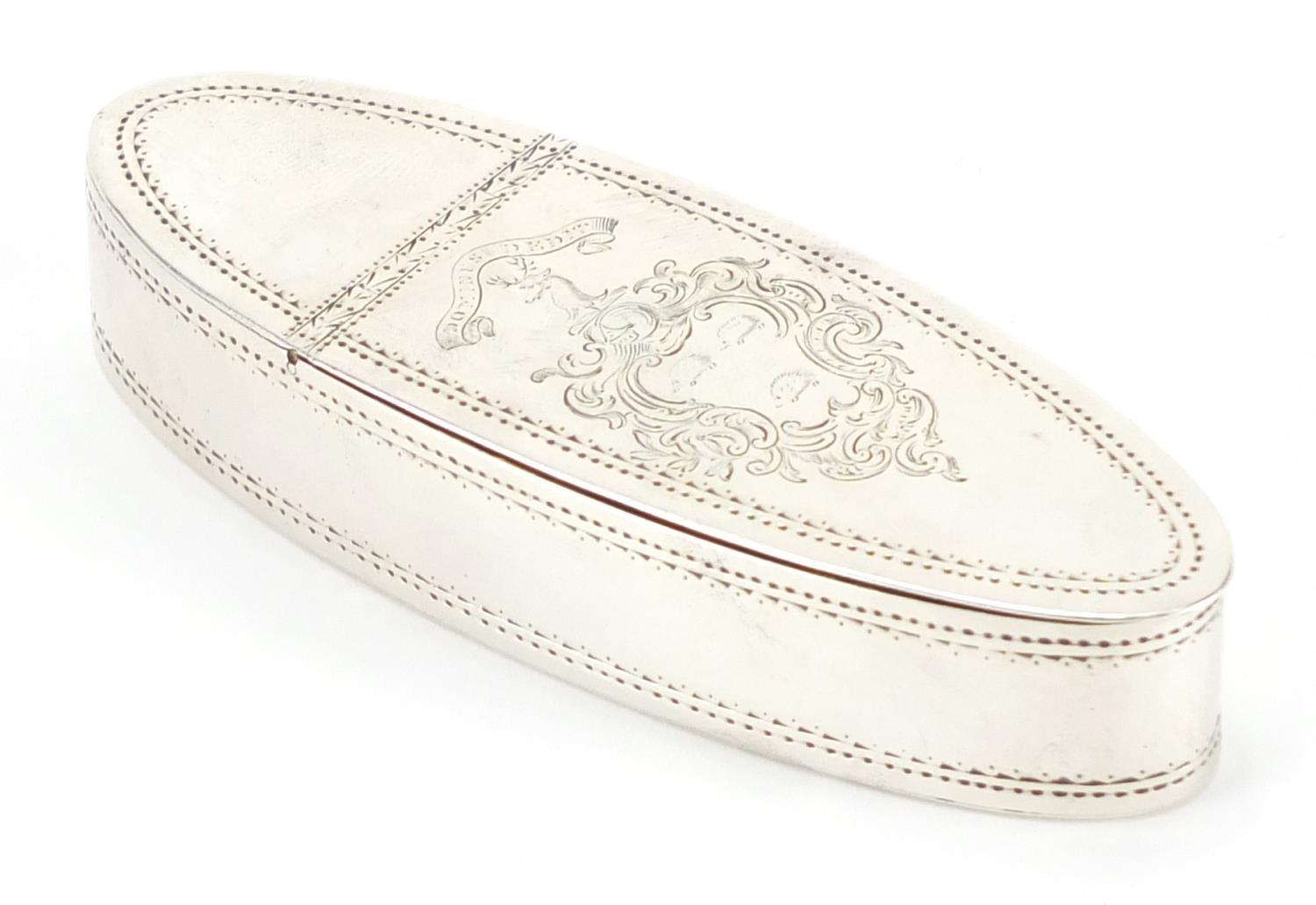 Lot 18 - Georgian silver snuff box with gilt interior, the hinged lid with engraved family crest and engraved