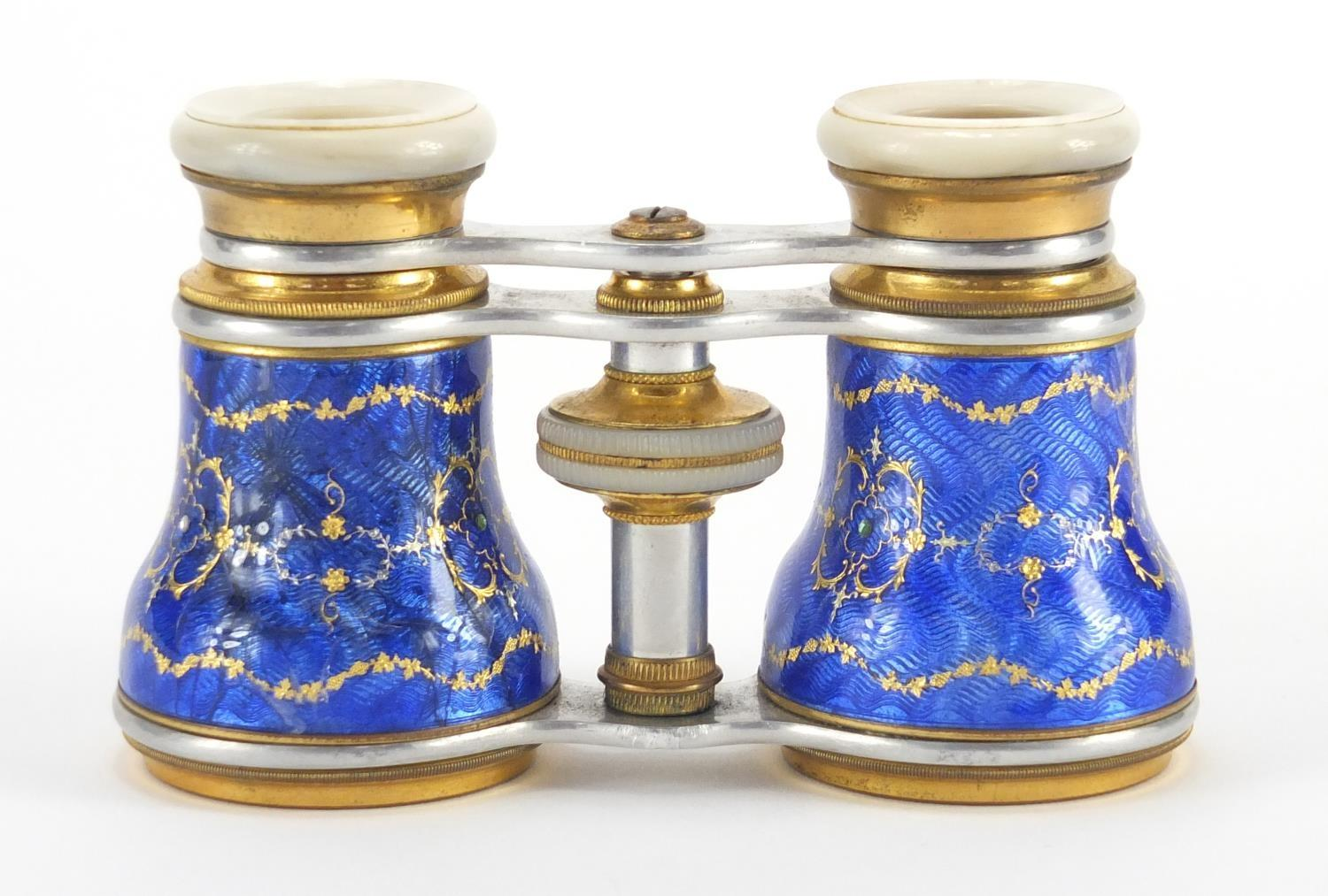Lot 23 - Pair of brass and Mother of Pearl opera glasses, the guilloche enamelled jewelled barrels